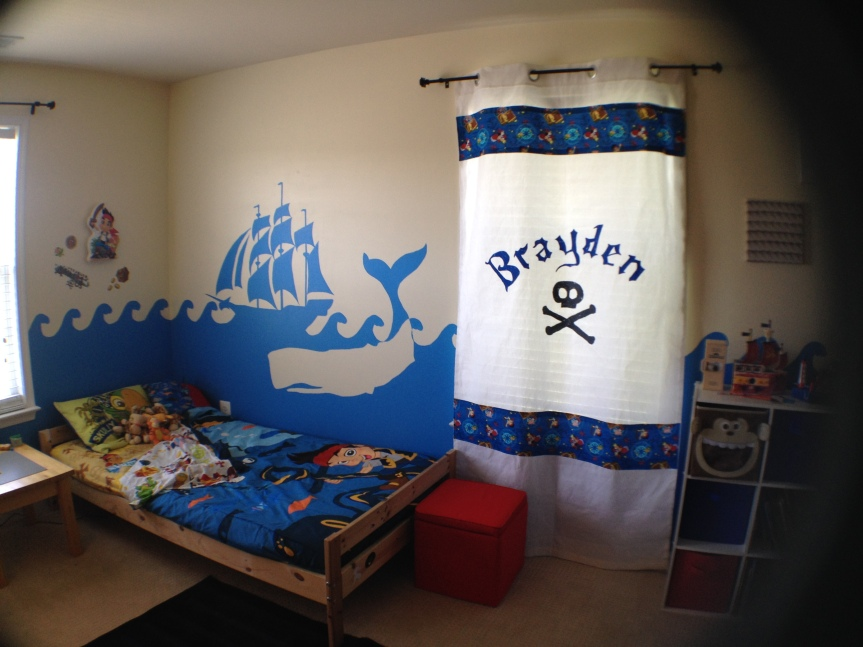 Finished curtain and mural with whale and ship