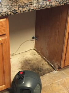 wet floor under dishwasher